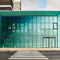 BAM marks 10 years on site at Aintree by handing over a new entrance to the Hospital's iconic tower block